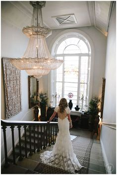 Our Whitehall wall hanging in gold velvet in the beautiful stairway at Castle Durrow, Ireland.  Emma Jervis Photography