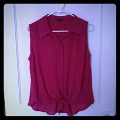 Express sleeveless fuchsia button up Gently worn Express tie front button up. The second picture more accurately shows the color. Express Tops Tank Tops