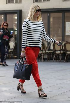 Classic combo: The Breton striped jumper worked well with her bright red trousers...