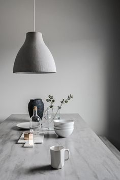 styling in grey hues. table, pendant and ceramics.