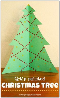 Q-tip painted Christmas tree. This is a great fine motor Christmas craft with such pretty results || Gift of Curiosity