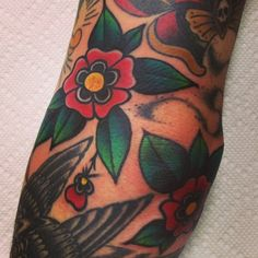 Traditional Flower Filler Tattoo by Greg Christian