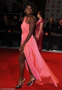 Brights: Viola Davis and Naomie Harris stood out in bright pink and yellow frocks that showed plenty of skin