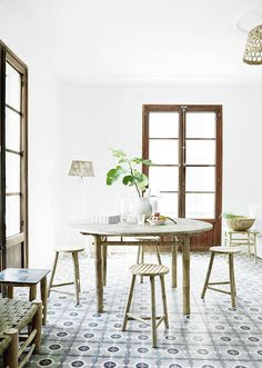 Tiles and bamboo furniture in a relaxed Danish oasis in Palma, Mallorca. Tine K Home.