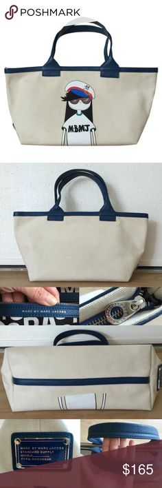 """MBMJ Miss Marc Character Canvas Leather Tote Very rare """"Miss Marc"""" off-white canvas tote with vibrant blue leather trim. In excellent condition with minimal corner wear and a minor stain next to the name plate as pictures (not noticable unless you look for it). Used with care. Interior is pristine. Measures 20"""" across at the top, 10"""" tall, 6"""" wide, and handles have a 7.5"""" drop. Smoke-free home. Marc by Marc Jacobs Bags Totes"""