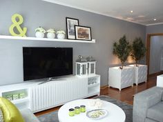 decorating around a tv interior design - love large shelf above the tv