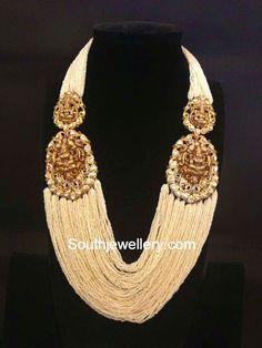 Multi String Pearls Mala with Lakshmi Side Pendants