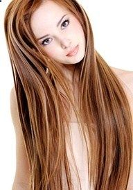 auburn hair with highlights and lowlights .