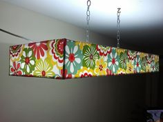 Sleek, modern rectangle pendant shade in vibrant floral. Custom made by CMB Designs Lamps and Shades, Trinidad