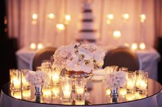 The mirrored tabletops plus candles ~ so gorgeous! Photography by esthersunphoto.com, Wedding Planning by mybridestory.com, Floral Design by themillefiori.com