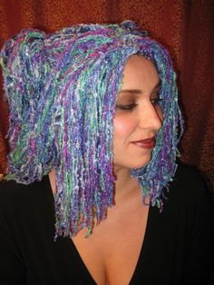 "My daughter crochets at ""13th HourDesigns"" on Etsy. She makes these incredible wigs! Check it out!"