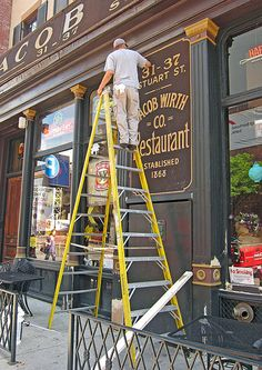 Touching up a restaurant sign in Boston.