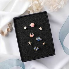 """Cute Universal Studs ✨ Save money with code """"firstorder"""" 😉 Comes with 2 stars and 2 planets (blue or pink) Choose Pink, Blue, or both while supplies last. Unique and eye catching studs. Rook Earring, Tragus Earrings, Cute Earrings, Opal Earrings, Ear Jewelry, Cute Jewelry, Jewelry Accessories, Cute Ear Piercings, Accesorios Casual"""