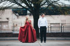 Okay...the attire in this session is so killer. Love her red gown and his semi-formal black-and-white attire! See more from this holiday red Knoxville wedding engagement session at Historic Railway Station by @leahbullard! | The Pink Bride® www.thepinkbride.com