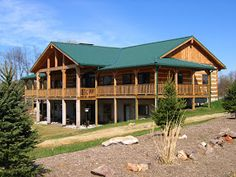 Log homes look great with metal roofs