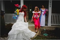 OMG, Disney Wedding. Woman is dressed as Ariel in a wedding dress... all bridesmaids are other characters... Aurora and Alice are behind her!