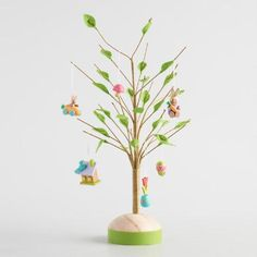 Trim your own Easter tree in fresh spring style. Crafted of wood with poseable wire branches and soft felt leaves, our tabletop tree creates a perfect display for miniature ornaments.