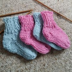 Knitted following the pattern here: http://knitting.about.com/od/patternsforbabies/p/Preemie-Infant-Socks.htm  Using 4mm needles and Rowan dk