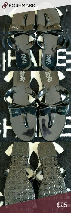COACH Pretty Bow Flip Flop Sandals EUC- Worn 1x for a couple hours  COACH Size 7.5 Color: Black  These sandals are easy-chic with their slip-on design and pretty bow detailing with Coach logo. Waterproof, stainproof. Coach Shoes Sandals