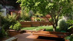 IPE DECK, BUILT IN BENCH WITH RECLINE, WOODEN RETAINING WALLS AND STAIRS, TERRACES