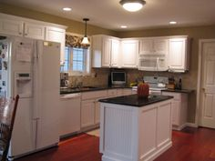 """Kitchen remodel on a small budget, We have a typical """"L"""" shaped kitchen with white cabinets."""