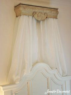 DIY Bed Crown using Hobby Lobby shelf, tension rod, and Sheer curtains. From Jenniferdecorates.com