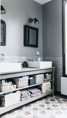 We've been playing it safe, color-wise, in the bathroom for a long time. Subway tile and white walls dominate, with maybe a grey tile on the floor for contrast. But that may all be about to change. More and more now we're starting to see bathrooms that embrace the darker, moodier colors. Here are our favorite designs.