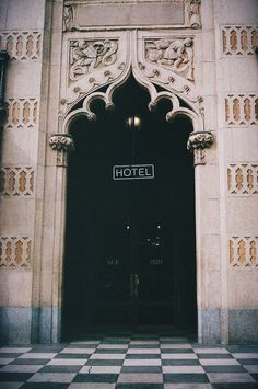 the ace hotel entrance with beautiful cut outs flanking the door