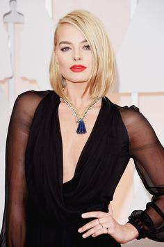 Margot glowed on the red carpet thanks to flawless skin, perfectly groomed brows, and a vibrant, creamy red lip. Re-create the look at home with Hourglass Opaque Rouge Liquid Lipstick in Raven ($28).