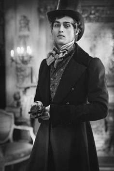 """Armand-like. """"He looked like a young man out of the novels of Dickens, in his somber and sleekly tailored black frock coat, all the Renaissance curls clipped away. His eternally youthful face was stamped with the innocence of a David Copperfield, and the pride of a Steerforth..."""""""