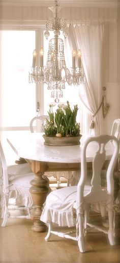 Romantic Shabby Chic - I don't like the all white idea, but I love the idea of the chair covers and the lighting.
