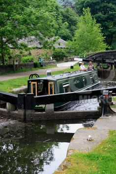 Narrowboat on one of England's many beautiful canals, a great way to experience peace and relaxation on holiday.