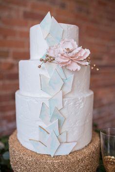Pretty geometric wedding cake. View the full wedding here: http://thedailywedding.com/2016/07/26/gatsby-glam-wedding-inspiration/