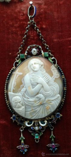 "Antique cameo of ""Penintent Magdalene""; set in silver, accented with enamel and precious stones."