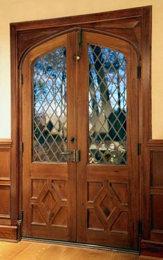 Double doors with diamond pane leaded glass. Note the diamond pattern panel common in early English doors.