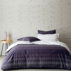 Square bedding adds so many elements to the bedroom with its marriage of the color plum and the plaid design. Its element of surprise is found on the opposite side of the duvet cover and shams as well as the flat sheet and boudoir sham. The same plaid design is brought to life in light and airy shades of gray. Pair with Vexin to add solid color items to your ensemble.