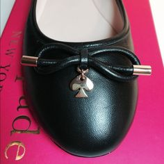 Kate Spade Ballerina Charm Flats - BLACK Price is firmNo offersGorgeous!!  Perfect condition!!  Solid black with adorable bow and gold spade charm. Leather with leather sole. No trades. kate spade Shoes Flats & Loafers