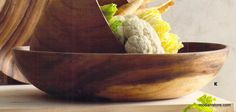 Graceful and simple design define the Acacia Wood Platter & Bowls. Hand-turned and hand-carved from renewable acacia wood, these unfinished bowls and plates are perfect for display or serving. The wood can be left as is for rustic elan or finished with a food-grade oil for serving.