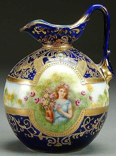 A NIPPON COBALT FOUR SEASONS PORCELAIN PORTRAIT EWER CIRCA 1900 DEPICTING A WOMAN WITH HAND PAINTED FLOWERS