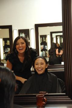 American Idol contestant Thia Megia having a great time while her hair is cut and styled for a performance by Atelier artist Alejandra.