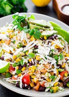 Mexican Chicken and Rice Salad - a fresh summer salad loaded with black beans, chicken, corn and rice. Totally addicting and makes the perfect dinner for a busy weeknight.