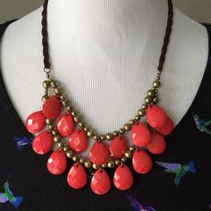 """pink beaded statement necklace Faceted deep pink teardrop beads sit alongside bronze ball beads on this festive statement necklace. Braided brown faux leather chain. Lobster clasp with 3"""" extender. Measures 11"""" long on lowest setting. Excellent condition! boutique Jewelry Necklaces"""