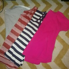Lot of 4 GAP tops 4 size medium tops. Left to right: grey tee with white eyelit backing (see last photo) red striped burnt out tank(looser fit), navy striped ribbed tank and a pink short sleeve v neck tee with a small pocket. Selling all together GAP Tops Tees - Short Sleeve