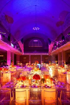 loving the color scheme...I think we can tone down the fuchsia a bit...h/e I love the glowing tables & sans the tablecloths!