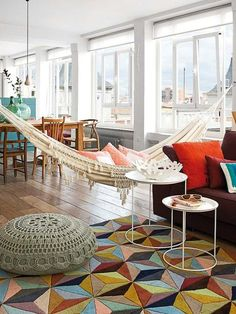 Indoor Hammocks to Take a Relaxing Snooze In Any Time Colorful and bright apartment with a hammock in the living roomColorful and bright apartment with a hammock in the living room Bright Apartment, Apartment Living, Studio Apartment, Apartment Ideas, Home Living Room, Living Spaces, Living Area, Indoor Hammock Bed, Room Hammock