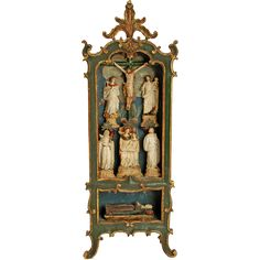 A very fine, rare late 18th century Portuguese colonial shrine from Brazil. Carved and polychrome painted wood with a 'Cristo' and various saints, each meticulously carved in piedra de huamanga -- a soft and pure form of alabaster that is mined in the quarries around Ayacucho. In pristine condition.  Dimensions: 24 inches high x 9 inches wide x 5 inches deep