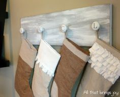 cute idea for hanging stalkings without a mantel... love how the knobs are the initials of each person
