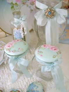 beautiful dresser jars with roses painted on their lids.