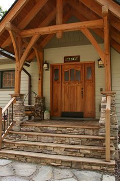I want a wooden deck with stone steps. And I absolutely love the mixture for the pillars.