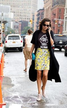 NYFW street style inspiration - a  graphic tee and a printed skirt paired with heels is fun and fancy.